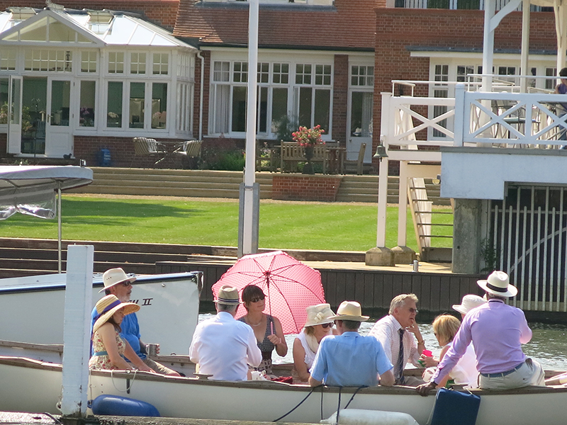 Lady with parasol on boat at Henley