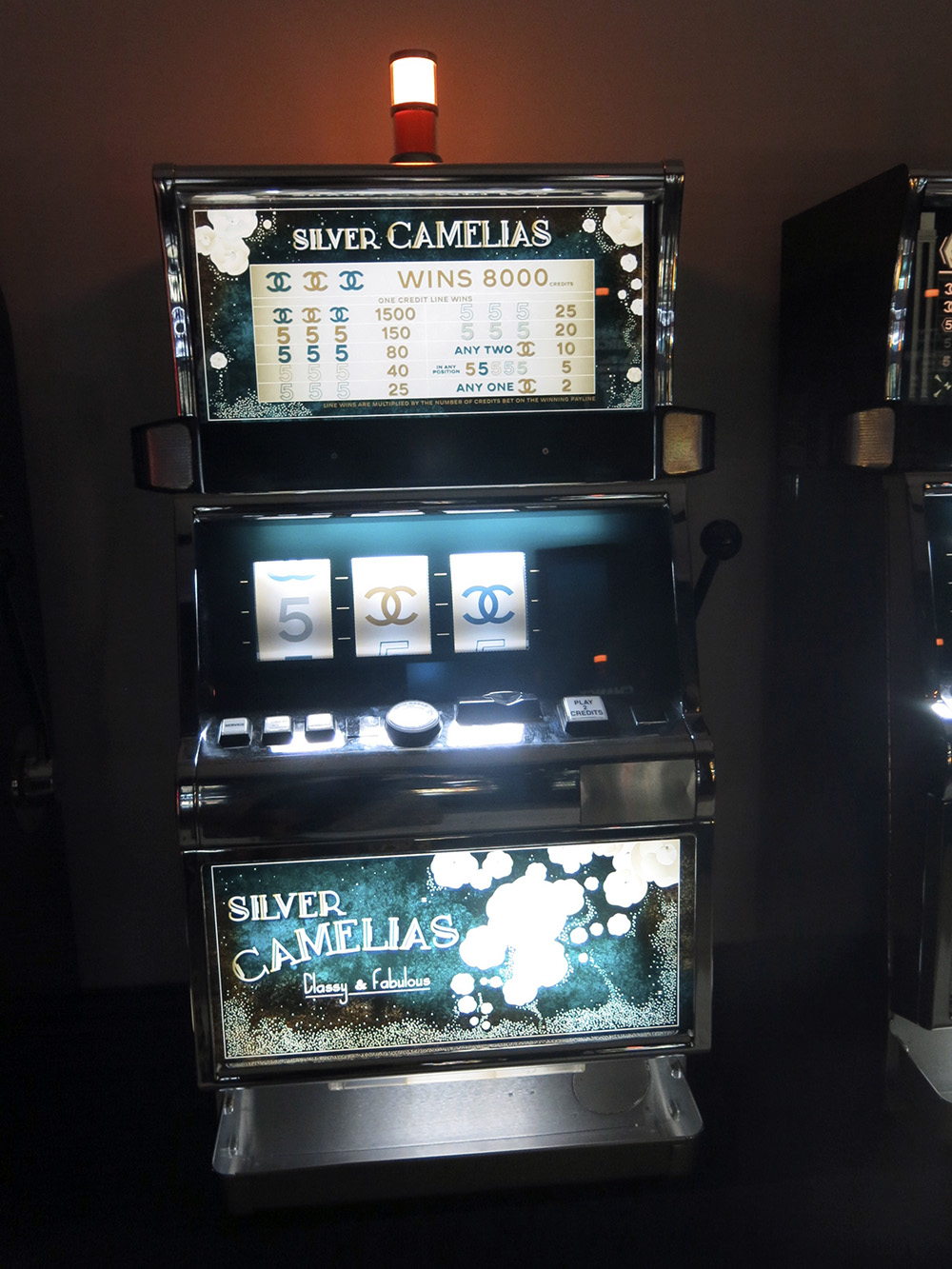 Chanel silver camelias slot machine
